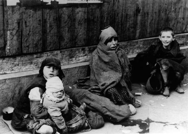 Starving children in Warsaw ghetto