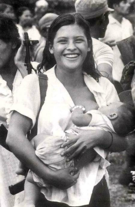 Armed Sandtinista Rebel breastfeeding (Nicarargua, 1984)