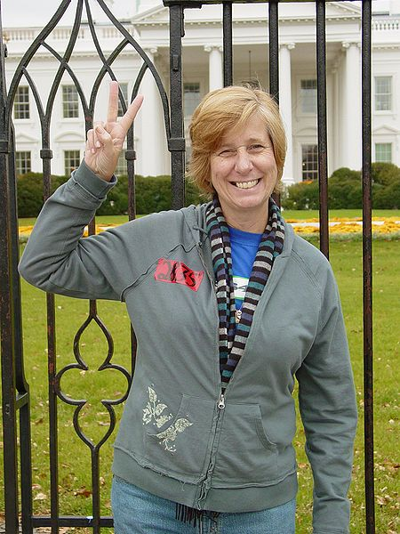 Cindy Sheehan gives the peace sign in front of the White House in 2006.