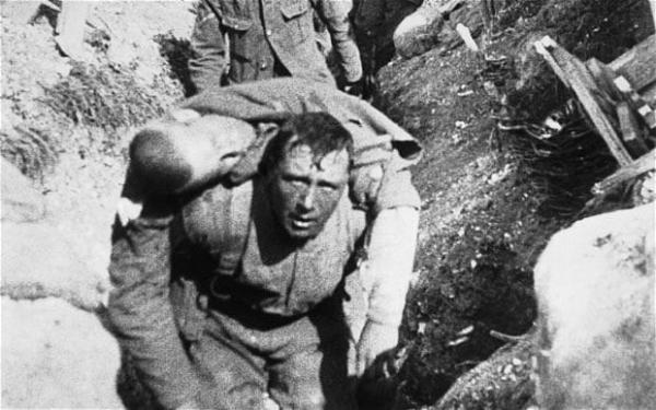 A soldier rescuing a comrade at The Battle Of The Somme