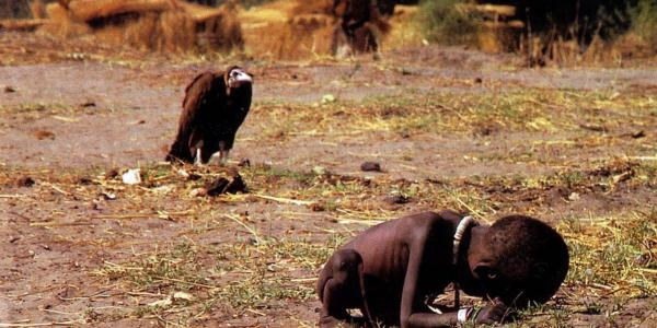 The prize-winning image: A vulture watches a starving child in southern Sudan, March 1, 1993.