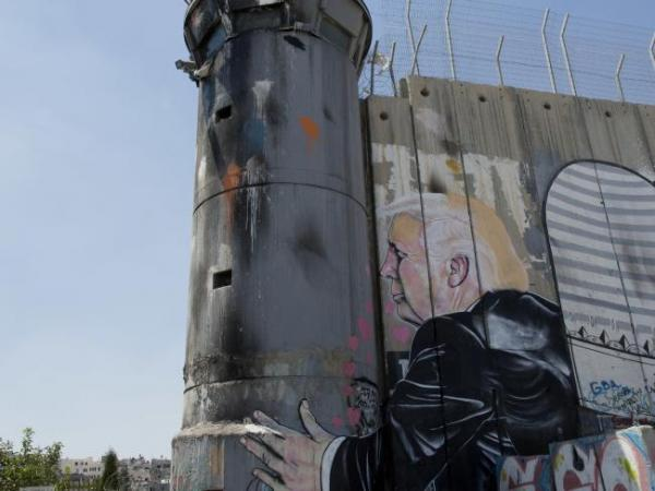 Banksy: President Donald Trump kissing an Israeli army watchtower in West Bank