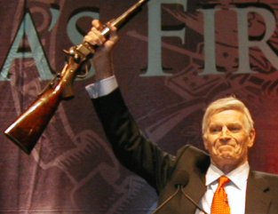 "Charlton Heston accepting a presentation rifle at 2000 NRA convention: ""From my cold, dead hands!"""