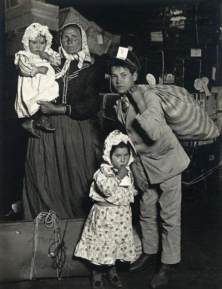 Italian family at Ellis Island. New York, 1905. By Lewis W. Hine