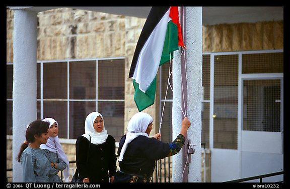 Women raise the Palestinian flag at a school in East Jerusalem.
