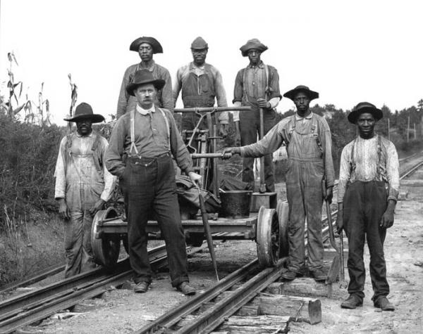 "Railroad negro workers with the ""Cap'n"""