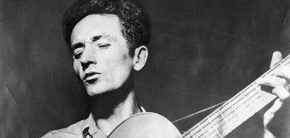 woody-guthrie-playing-guitar-631 0