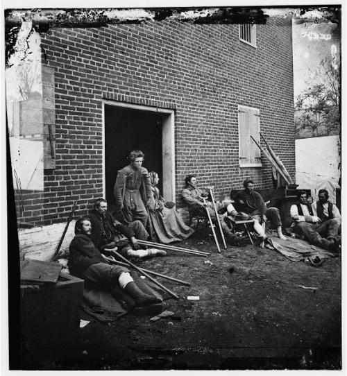 "Wounded soldiers from the battles in the ""Wilderness"" at Fredericksburg, Virginia, May 1864"